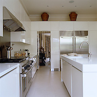 White lacquer adds a note of 1930s glamour to this elegant kitchen