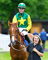 Winner of The Shadwell Stud Racing Excellence Apprentice Handicap Madrinho ridden by Poppy Bridgewater and trained by Tony Carroll  is led into the winners enclosure during Afternoon Racing at Salisbury Racecourse on 12th June 2018