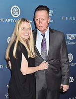 LOS ANGELES, CA - JANUARY 05: Barbara Patrick (L) and Robert Patrick attend Michael Muller's HEAVEN, presented by The Art of Elysium at a private venue on January 5, 2019 in Los Angeles, California.<br /> CAP/ROT/TM<br /> &copy;TM/ROT/Capital Pictures