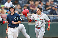 Dean Long (16) of the Spokane Indians returns to the dugout after hitting a home run during a game against the Everett AquaSox at Everett Memorial Stadium on July 24, 2015 in Everett, Washington. Everett defeated Spokane, 8-6. (Larry Goren/Four Seam Images)