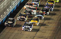Nov. 7, 2008; Avondale, AZ, USA; Nascar Craftsman Truck Series driver Ron Hornaday Jr (33) and Kyle Busch (51) lead the field on the first lap during the Lucas Oil 150 at Phoenix International Raceway. Mandatory Credit: Mark J. Rebilas-
