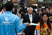 A campaigner with the Happiness Realization Party handing out fliers in Shibuya, Tokyo, Japan Wednesday, May 26th 2010