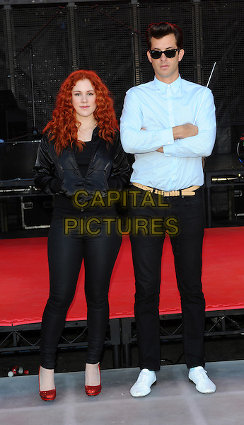"Katy B (Kathleen ""Katie"" Brien) & Mark Ronson.Launch of Coca-Cola's London 2012 Olympic Games global marketing campaign at Formanís Fish Island.London, England..29th, September 2011.full length black jacket jeans denim blue shirt arms crossed sunglasses shades .CAP/CJ.©Chris Joseph/Capital Pictures."
