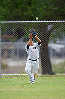 Western Connecticut Colonials center fielder Joel Luna (21) catches a fly ball during the second game of a doubleheader against the Edgewood College Eagles on March 13, 2017 at the Lee County Player Development Complex in Fort Myers, Florida.  Edgewood defeated Western Connecticut 3-1.  (Mike Janes/Four Seam Images)