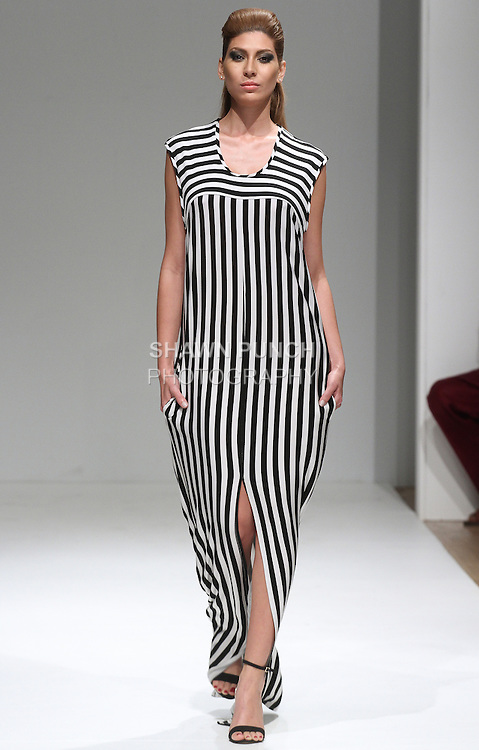 Model walks runway in an outfit from the Adrian Foster Spring Summer 2015 collection, at Fashion Gallery New York Fashion Week Spring Summer 2015, during New York Fashion Week Spring 2015.