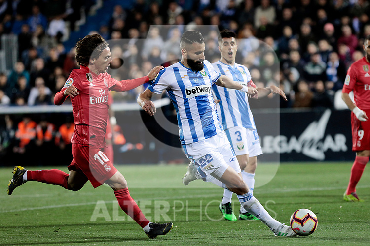 CD Leganes's Dimitrios Siovas and Real Madrid's Luka Modric during La Liga match between CD Leganes and Real Madrid at Butarque Stadium in Leganes, Spain. April 15, 2019. (ALTERPHOTOS/A. Perez Meca)