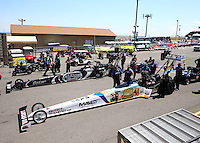 Jul. 21, 2013; Morrison, CO, USA: NHRA top fuel dragster driver Brandon Bernstein (near lane) is alongside Shawn Langdon in the staging lanes as crew members stand by during the Mile High Nationals at Bandimere Speedway. Mandatory Credit: Mark J. Rebilas-