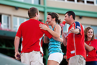 A girl reacts after being proposed to between innings during a game between the Northwest Arkansas Naturals and the Springfield Cardinals at Hammons Field on June 14, 2012 in Springfield, Missouri. (David Welker/Four Seam Images)