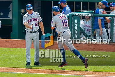 30 April 2017: New York Mets outfielder Jay Bruce rounds third, getting a handshake from third base coach Glenn Sherlock, after hitting a solo home run in the 3rd inning against the Washington Nationals at Nationals Park in Washington, DC. The Nationals defeated the Mets 23-5 in the third game of their weekend series. Mandatory Credit: Ed Wolfstein Photo *** RAW (NEF) Image File Available ***