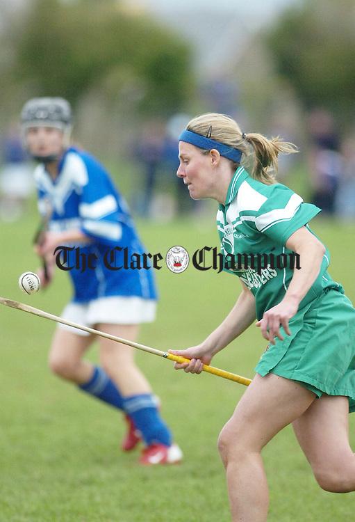 Kilnamona Captain Catherine O'Loughlin clears her defence against Kilmaley in the Senior Camogie Final in Roslevan.Pic Arthur Ellis.