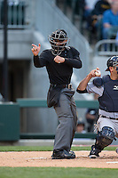 Home plate umpire Joey Amaral makes a strike call during the International League game between the Scranton\Wilkes-Barre RailRiders and the Charlotte Knights at BB&T BallPark on May 1, 2015 in Charlotte, North Carolina.  The RailRiders defeated the Knights 5-4.  (Brian Westerholt/Four Seam Images)