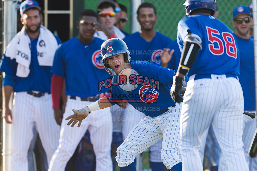 AZL Cubs 1 right fielder Ezequiel Pagan (1) congratulates Rafael Mejia (58) after hitting a home run during an Arizona League game against the AZL Indians 1 at Sloan Park on August 27, 2018 in Mesa, Arizona. The AZL Cubs 1 defeated the AZL Indians 1 by a score of 3-2. (Zachary Lucy/Four Seam Images)