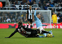 30th November 2019; St James Park, Newcastle, Tyne and Wear, England; English Premier League Football, Newcastle United versus Manchester City; Allan Saint-Maximin of Newcastle United and Kyle Walker of Manchester City challenge for the ball - Strictly Editorial Use Only. No use with unauthorized audio, video, data, fixture lists, club/league logos or 'live' services. Online in-match use limited to 120 images, no video emulation. No use in betting, games or single club/league/player publications