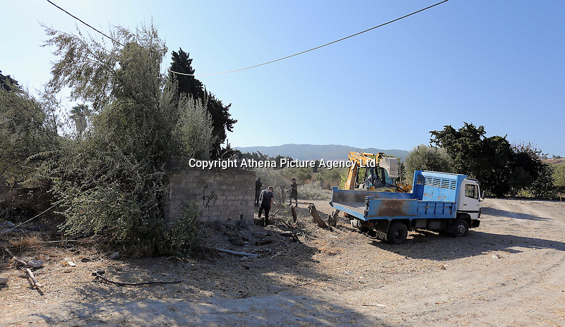 Pictured: A digger is used to search the land adjacent to a disused building in a field in Kos, Greece. Saturday 01 October 2016<br /> Re: Police teams led by South Yorkshire Police, searching for missing toddler Ben Needham on the Greek island of Kos have moved to a new area in the field they are searching.<br /> Ben, from Sheffield, was 21 months old when he disappeared on 24 July 1991 during a family holiday.<br /> Digging has begun at a new site after a fresh line of inquiry suggested he could have been crushed by a digger.