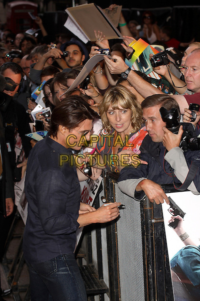 """TOM CRUISE.""""Knight and Day"""" UK film premiere, Odeon cinema Leicester Square, London, England, UK..July 21st 2010.half length blue navy shirt sunglasses shades profile fans crowd signing autographs .CAP/AH.©Adam Houghton/Capital Pictures."""
