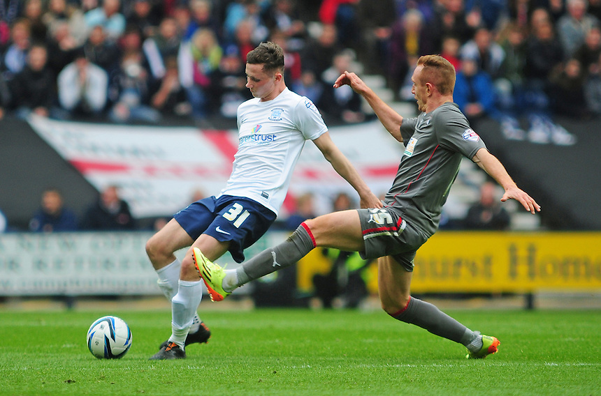 Preston North End's Alan Browne under pressure from Rotherham United's Robert Milsom <br /> <br /> Photographer Chris Vaughan/CameraSport<br /> <br /> Football - The Football League Sky Bet League One Play-Off First Leg - Preston North End v Rotherham United - Saturday 10th May 2014 - Deepdale - Preston<br /> <br /> &copy; CameraSport - 43 Linden Ave. Countesthorpe. Leicester. England. LE8 5PG - Tel: +44 (0) 116 277 4147 - admin@camerasport.com - www.camerasport.com