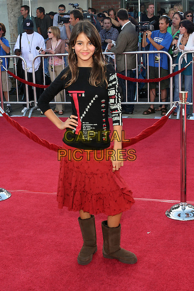 "VICTORIA JUSTICE.Los Angeles Premiere of ""Dreamer"" held at the Mann Village Theater.9th October 2005.Ref:ADM/ZL.full length black red white text print printed t-shirt top boho tiered gypsy skirt brown ugg comfy sheep wool boots hand on hip hips .sales@capitalpictures.com.©Zach Lipp/AdMedia/Capital Pictures."