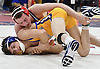Joseph Vacca of St. John the Baptist, top, battles Sean Coakley of Kellenberg at 113 pounds during the NSCHSAA varsity wrestling championships at St. John the Baptist High School on Sunday, Feb. 5, 2017. Vacca won the match.