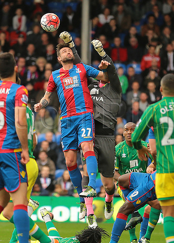 09.04.2016. Selhurst Park, London, England. Barclays Premier League. Crystal Palace versus Norwich. Norwich City Goalkeeper John Ruddy clears a Crystal Palace corner as Crystal Palace Defender Damien Delaney puts in a climbing challenge