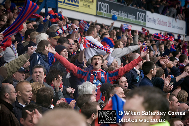 Crystal Palace supporters celebrating at Hillsborough after the final whistle of the crucial last-day relegation match against Sheffield Wednesday. The match ended in a 2-2 draw which meant Wednesday were relegated to League 1. Crystal Palace remained in the Championship despite having been deducted 10 points for entering administration during the season.