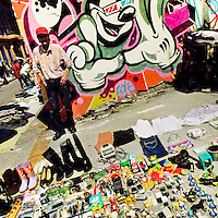 A Colombian man sells junk items in front the wall, covered in a graffiti artwork, during the flea market in the center of Bogotá, Colombia, 13 March, 2016. A social environment full of violence and inequality (making the street art an authentic form of expression), with a surprisingly liberal approach to the street art from Bogotá authorities, have given a rise to one of the most exciting and unique urban art scenes in the world. While it's technically not illegal to scrawl on Bogotá's walls, artists may take their time and paint in broad daylight, covering the walls of Bogotá not only in territory tags and primitive scrawls but in large, elaborate artworks with strong artistic style and concept. Bogotá has become an open-air gallery of contemporary street art.
