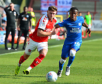 Fleetwood Town's Wes Burns vies for possession with Peterborough United's Siriki Dembele<br /> <br /> Photographer Richard Martin-Roberts/CameraSport<br /> <br /> The EFL Sky Bet League One - Fleetwood Town v Peterborough United - Friday 19th April 2019 - Highbury Stadium - Fleetwood<br /> <br /> World Copyright © 2019 CameraSport. All rights reserved. 43 Linden Ave. Countesthorpe. Leicester. England. LE8 5PG - Tel: +44 (0) 116 277 4147 - admin@camerasport.com - www.camerasport.com