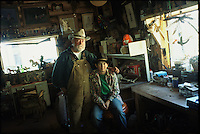 BASIN - 2003: A father and son pose for a portrait in their workshop in Basin, Montana.  (photo by Landon Nordeman)