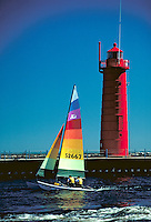 Sailboat returning from Lake Michigan, lighthouses, boat, boats. Muskegon Michigan USA.