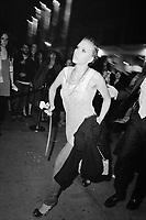 Scarlett Johansson walking into the Imitation of Christ fashion show, NYC, 2006