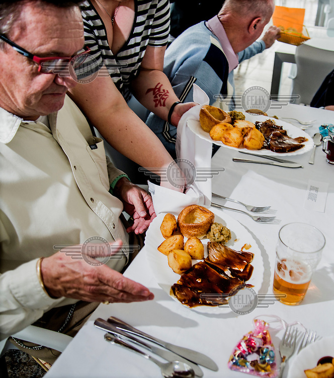 Mike, a former member of the RAF and the president of the The English Speaking Club El Campello, is served a roast beef dinner. Spain is home to more British ex-pats than anywhere else in the world, mostly concentrated in its Mediterranean regions and there are numerous clubs and organisations catering to this population.