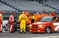 Pole Weekend for the 87th Indianapolis 500, Indianapolis Motor Speedway, Speedway, Indiana, USA  25 May,2003.Billy Boat (center, yellow & black uniform) surveys the damage to his car after hitting the end of the pit lane wall during pole day practice..World Copyright©F.Peirce Williams 2003 .ref: Digital Image Only..F. Peirce Williams .photography.P.O.Box 455 Eaton, OH 45320.p: 317.358.7326  e: fpwp@mac.com..
