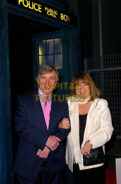 "NERYS HUGHES & GUEST.Attending the ""Doctor Who"" Christmas Special Gala Screening held at the Science Museum,.London, England, December 19th 2007..Dr Dr. half length pink tie Tardis.CAP/CAN.©Can Nguyen/Capital Pictures"