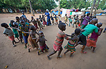 Children play in a camp for internally displaced persons that formed around the Our Lady of Assumption Catholic Church in Riimenze, South Sudan. The parish has provided food, shelter material, and health care, and the presence of the local priest and a group of religious has contributed to a sense of relative safety.