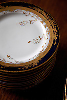 A detail of the delicately painted gold foliage that decorates all of the formal dinner service