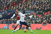 10th February 2018, Wembley Stadium, London England; EPL Premier League football, Tottenham Hotspur versus Arsenal; Pierre-Emerick Aubameyang of Arsenal tackles David Sanchez of Tottenham Hotspur