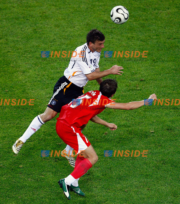 Dortmund 14/6/2006 World Cup 2006.Germany Poland - Germania Polonia 1-0.Photo Andrea Staccioli Insidefoto.Bernd Schneider Germany Ebi Smolarek Poland