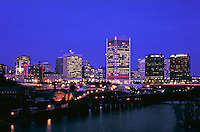 The Richmond Virginia skyline at dusk, as seen from a bridge over the James River. Richmond Virginia USA.