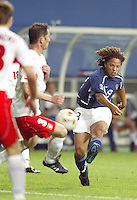 Cobi Jones takes a shot. The USA lost 3-1 against Poland in the FIFA World Cup 2002 in Korea on June 14, 2002.