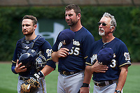 Milwaukee Brewers catcher Jonathan Lucroy (20) bullpen catcher Marcus Hanel (55) and bullpen coach Lee Tunnell (43) during the national anthem before a game against the Chicago Cubs on August 13, 2015 at Wrigley Field in Chicago, Illinois.  Chicago defeated Milwaukee 9-2.  (Mike Janes/Four Seam Images)