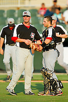 Hickory Crawdads relief pitcher Sam Stafford (24) shakes hands with catcher David Lyon (36) after closing out the South Atlantic League game against the Kannapolis Intimidators at CMC-Northeast Stadium on July 28, 2013 in Kannapolis, North Carolina.  The Crawdads defeated the Intimidators 6-1.  (Brian Westerholt/Four Seam Images)