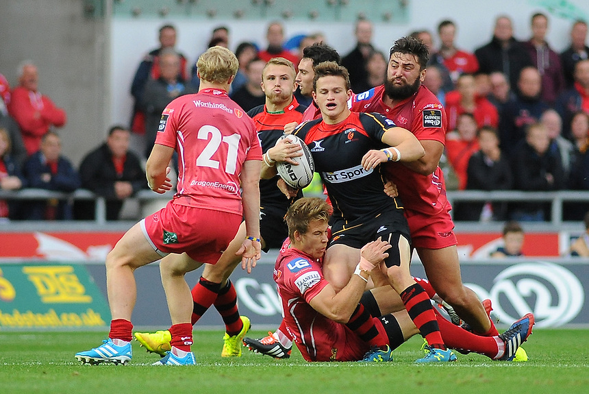 Newport Gwent Dragons' Hallam Amos is tackled by Scarlets' Liam Williams <br /> <br /> Photographer Kevin Barnes/CameraSport<br /> <br /> Rugby Union - Guinness PRO12 - Scarlets v Newport Gwent Dragons - Sunday 05th October 2014 - Parc y Scarlets - Llanelli<br /> <br /> &copy; CameraSport - 43 Linden Ave. Countesthorpe. Leicester. England. LE8 5PG - Tel: +44 (0) 116 277 4147 - admin@camerasport.com - www.camerasport.com