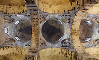 Interior view from below of the three red domes, Chiesa di San Cataldo (Church of San Cataldo, La Cataldo), 1154, Palermo, Sicily, Italy. The Romanesque church with Arab influences was founded by Maio of Bari, chancellor to William I, during the Norman occupation of Sicily. Picture by Manuel Cohen