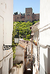 Narrow alleyway named Candil in the Moorish housing district of Albaicin, Granada, Spain