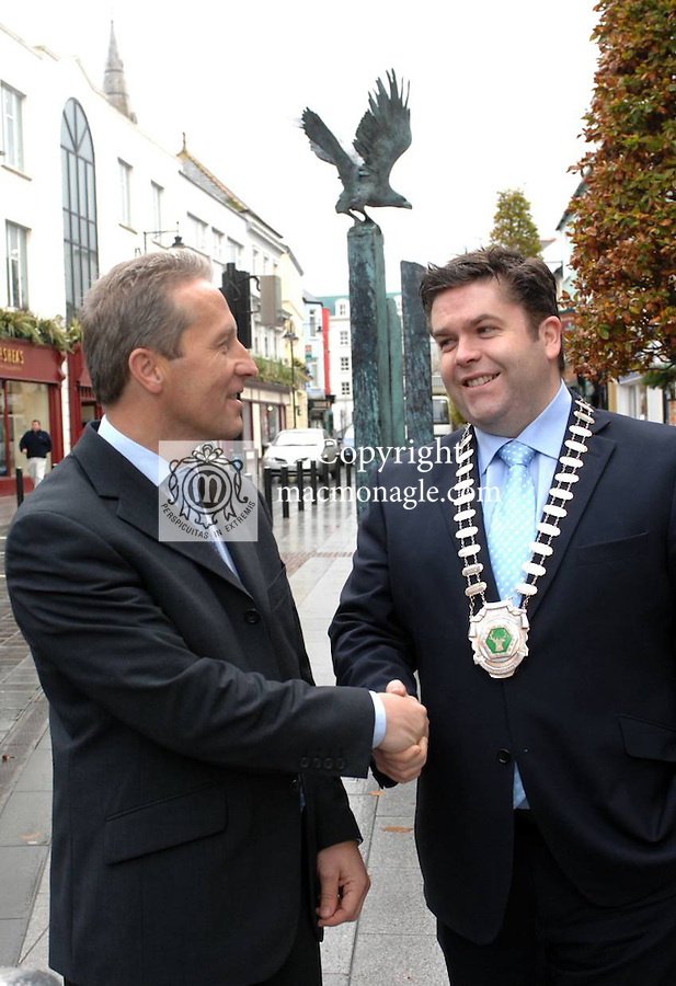 Killarney hotelier Tom Randles is congratulated by outgoing president Donnacha Galvin after he was elected president Killarney Chamber of Tourism & Commerce this week. Mr Randles is priorietor of the Randles Court Hotel on the Muckross Road..Picture by Don MacMonagle