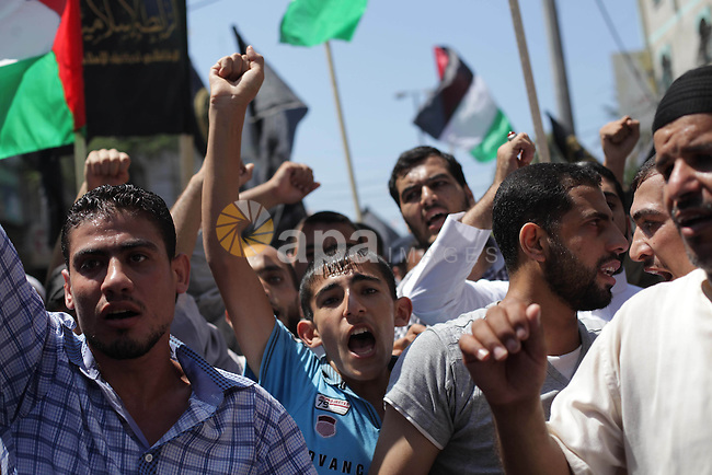 "Palestinians take part in a protest as they mark Quds Day or Jerusalem Day in Gaza city, Friday, Aug. 02, 2013. The late Iranian leader Ayatollah Khomeni declared the last Friday of the Islamic fasting month of Ramadan as ""al-Quds Day,"" a day of protest to show the importance of Jerusalem to Muslims. Jerusalem is the third holiest site in Islam after the Saudi Arabian cities of Mecca and Medina. Photo by Ashraf Amra"
