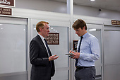 United States Senator James Lankford (Republican of Oklahoma) speaks with a reporter in the Senate Subway at the United States Capitol Building on a day when Congress tries to pass a spending bill to avoid a government shutdown in Washington, D.C. on January 19th, 2018. Credit: Alex Edelman / CNP