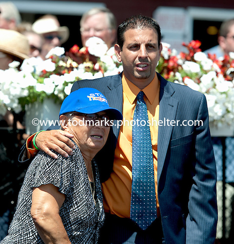 Mike Repole, with his grandmother, won the second race with Giant Surprise, an impressive maiden, but the horse was hurt.