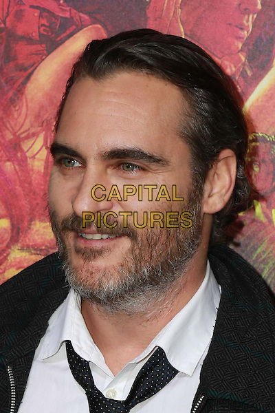 HOLLYWOOD, CA - DECEMBER 10: Joaquin Phoenix at the Inherent Vice Premiere at the TCL Chinese Theater in Hollywood, CA on December 10, 2014.  <br /> CAP/MPI/DC/DE<br /> &copy;DE/DC/MPI/Capital Pictures