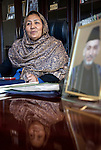 November 2012, Bamiyan, Afghanistan:  Govenor of Bamiyan Province Habiba Sarabi at her office with portraits of Afghan president Hamid Karzai.  Ethnic Hazara's ,who have often made up vast numbers of refugees to Australia, having been persecuted and driven from their homes in both Afghanistan as well as from Quetta in Pakistan where a lot of displaced Hazara fled to during the Taliban years. Bamiyan is home to a lot of Hazara who are Shia muslim and as such are looked down upon by the Sunni Pashto tribes that make up the population majority in Afghanistan. Picture by Graham Crouch/The Australian Magazine.