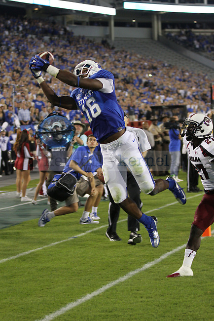 University of Kentucky's senior La'Rod King tries to real in the ball in the corner of the end zone in Lexington, Ky., on Saturday, September, 29, 2012. Photo by James Holt | Staff